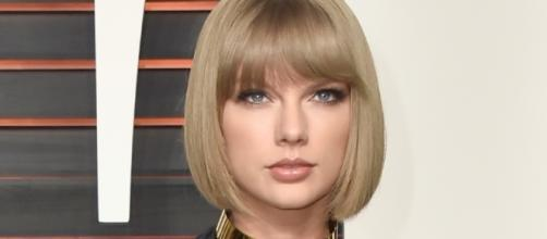 Taylor Swift has been allegedly dating a young British actor Joe Alwyn. Photo via - hercampus.com