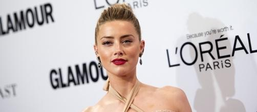 "Amber Heard is keeping herself busy with ""Aquaman"" following her divorce with Johnny Depp. (via Valerie Macon/AFP)"