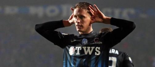 Andrea Conti esulta dopo il gol