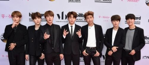 K-Pop band and Top Social Artist BTS pose for Billboard's Magenta Carpet. Photo via Billboard, billboard.com