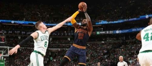 LeBron and the Celtics are moving on to the NBA Finals after routing Boston in Game 5. [Image via Blasting News image library/nba.com]