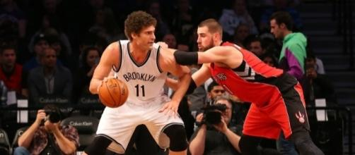 Brook Lopez, starting center for the Brooklyn Nets, backing down Jonas Valanciunas of the Toronto Raptors - nothinbutnets.com