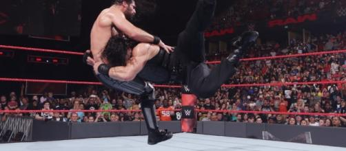 Roman Reigns hits a Spear on his Shield brother Seth Rollins on RAW/Photo via WWE