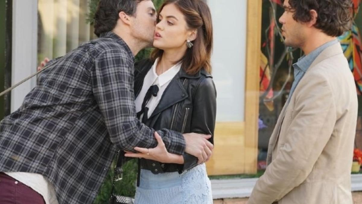do aria and ezra dating in real life