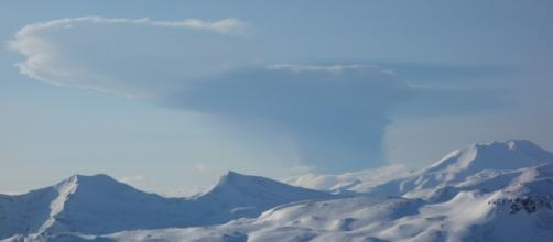 Highest aviation alert level issued after Alaskan volcano erupts: Bogoslof eruption seen from Unalaska Island. / from 'CNN' - cnn.com