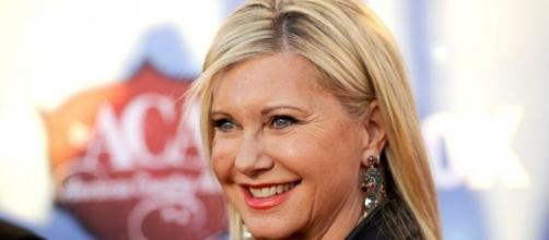 Olivia Newton-John Opens Up About Family's Painful Cancer Battles ... - go.com
