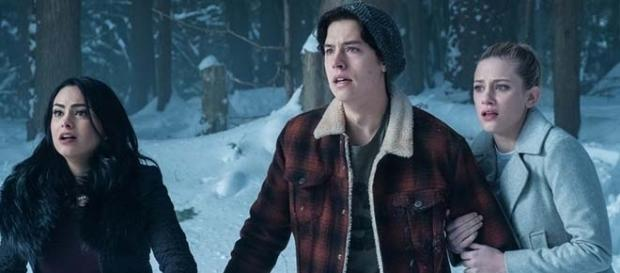 "Cami Mendes, Cole Sprouse, and Lili Reinhart are returning to reprise their role for a darker sophomore season of ""Riverdale."" (SpoilerTV/The CW)"