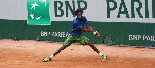 Gael Monfils plays backhand shot during practice. Photo by ThoamsB -- CC BY-ND 2.0