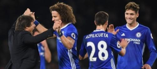 Chelsea celebrating following their 3-0 win- mirror.co.uk