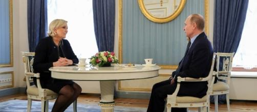 Marine Le Pen (left) meets with Vladimir Putin (right). Photo Credit: Mikhail Klimentyev