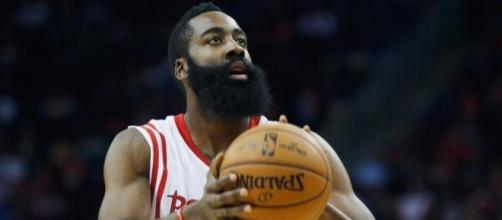 James Harden will try to help the Rockets even things with the Spurs on Sunday night. [Image via Blasting News image library/sportsonearth.com]