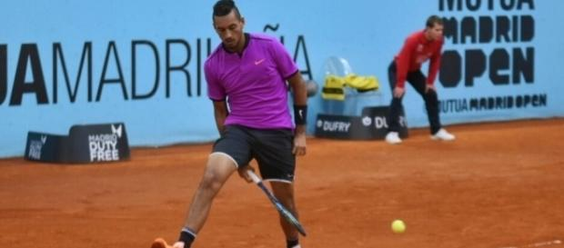 Nick Kyrgios plays a tweener against Marcos Baghdatis at the Madrid Masters. Photo-- Twitter/@MutuaMadridOpen