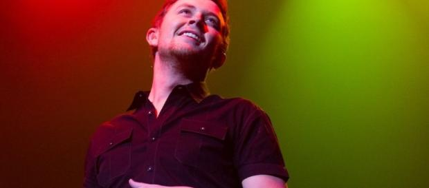 "Scotty McCreery implores listeners to cherish all the little moments of love and life in ""Five More Minutes.""