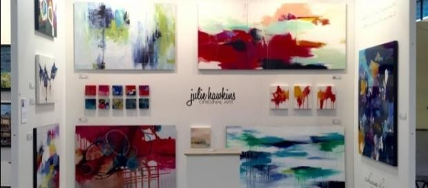 An array of Julie's cheerful artwork. / Photo via Julie Hawkins, used with permission.
