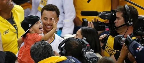 Steph Curry shares NBA champion title with wife and kids. Photo - go.com