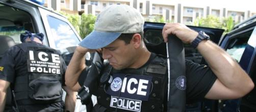 US ICE agents/ photo courtesy of Wikimedia Commons/ https://commons.wikimedia.org/wiki/File:US_Immigration_and_Customs_Enforcement_SWAT.jpg