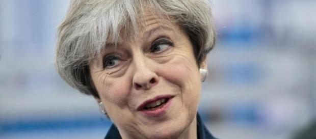 Theresa May hits back after wave of criticism for new ... - thesun.co.uk