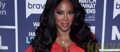 Kenya Moore got married once more to a mystery man in Saint Lucia. Photo via YouTube/E! News
