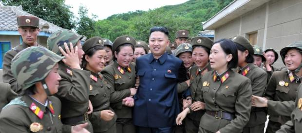 Kim Jong-Un with citizens of North Korea