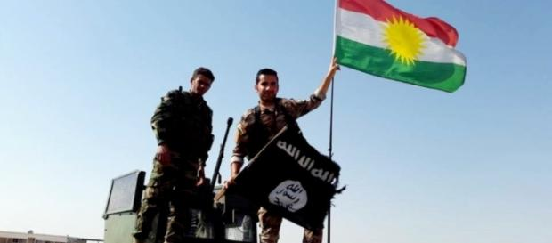 Peshmerga throw away the ISIS flag and hang up the Kurdish… | Flickr - flickr.com