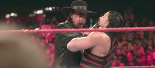 Is The Undertaker set to make a return to avenge his loss to Roman Reigns? [Image via WWE/YouTube]