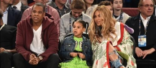Jay Z and Beyonce along with their daughter Blue Ivy. (Photo by: popsugar.com/Blasting News Library)