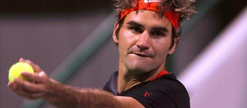 Swiss tennis ace Roger Federer serves/ Image creative common wiki via Vinod Vakaran www.dohastadiumplusqatar.com