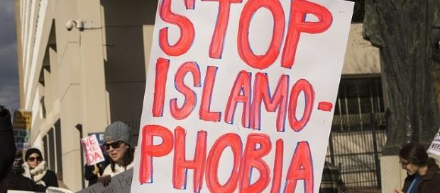 Islamophobia credits:wikimedia https://commons.wikimedia.org/wiki/File:Anti_Trump_immigration_protest_in_Baltimore_DSC_6631_(32445497342).jpg
