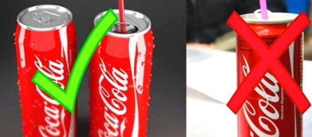 Latinhas de refrigerante com canudo em local correto