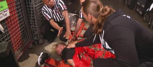 Big Cass checks on his tag team partner Enzo backstage on 'Monday Night Raw.' [Image via Blasting News image library/inquisitr.com]