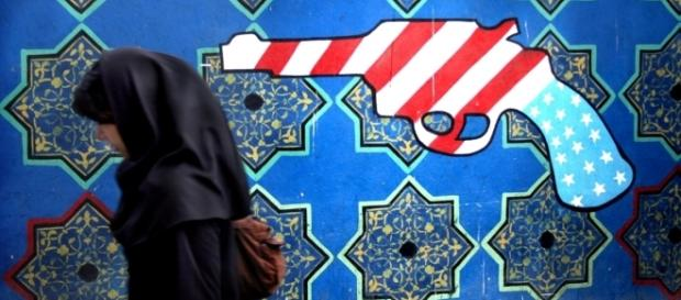 Mural in Iran representing western aggression against Muslims. / Image by Örlygur Hnefill via Flickr:https://flic.kr/p/3hiAso | CC BY 2.0