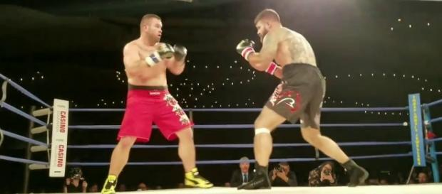 Tim Hague (left) died after his bout against Adrian Braidwoods. [Image via YouTube/MMA News]