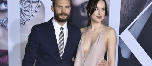 Jamie Dornan and Dakota Johnson had debunked rumors claiming that they are dating. Photo by Jordan Strauss/Invision/AP Images