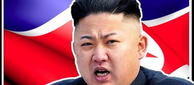 Kim Jong-un's mugshot now adorns a male romper. [Image via YouTube/Think Tank]