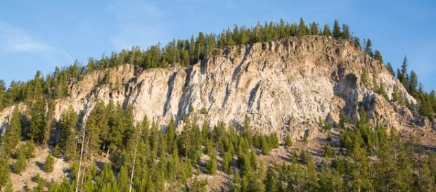 Volcanic activity spotted at Yellowstone. Tuff Cliff reveals an ash flow welded into rock. [Image via NPS/Neal Herbert]
