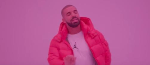 A new Drake song called 'Signs' was released exclusively through a Louis Vuitton fashion show's streaming feed. [Image via DrakeVEVO/YouTube]