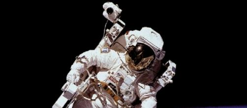 NASA Space Suit in Use (Courtesy NASA)