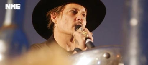 Photo Johnny Depp at Glastonbury photo capture from YouTube video/NME