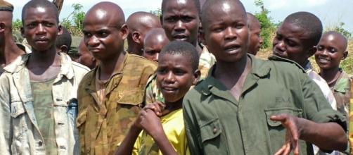 Child soldiers - By L. Rose [Public domain], via Wikimedia Commons