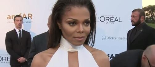 Janet Jackson is very happy being a mother to son Eissa. Image via YouTube/E!News
