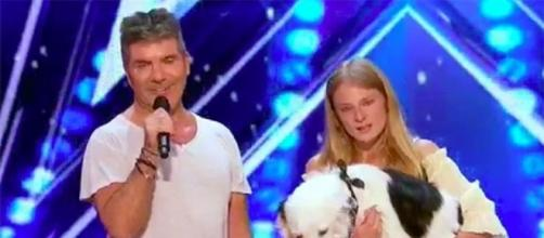 "Simon Cowell stands up to appeal for a talented dog and the training of his mistress on ""America's Got Talent""--AGT/YouTube"