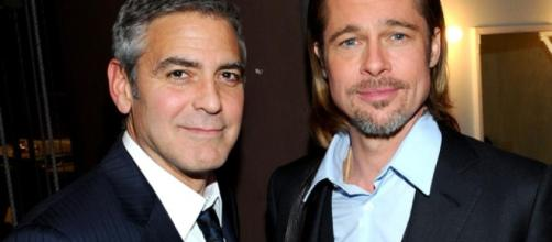 George Clooney's close friend Brad Pitt finally meet his twins while bringing gifts and advices.