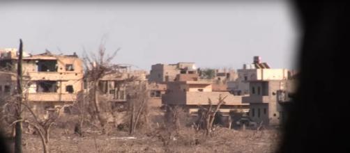 Syrian troops' view of Deir ez-Zor. / [Image screenshot AFP via YouTube:https://youtu.be/KSW0mnGvE9U]