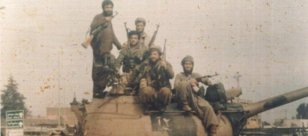 Kurdish troops gleefully poses in the midst of an offensive against ISIS - Wikipedia - wikipedia.org