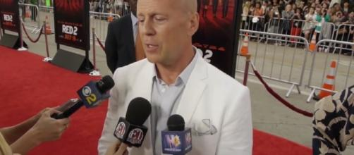 Bruce Willis brought his family to Disneyland for a getaway. Image via YouTube/Hollyscoop