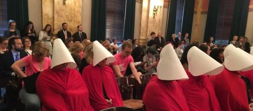 "A group of women stage a silent protest against Ohio Senate bill 145 dressed as characters from ""The Handmaid's Tale."""