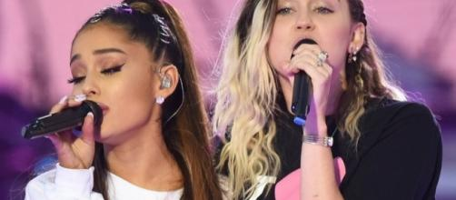 Ariana Grande and Miley Cyrus singing 'Don't Dream It's Over' during 'One Love Manchester' concert. (Photo: toofab.com)