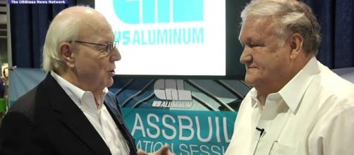 Lyle Hill talks with Donald Friese of C.R. Laurence. Photo via USGlassMag, YouTube.