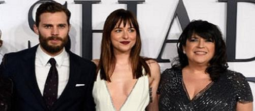 Jamie Dornan, Dakota Johnson with E.L. James / Photo via Fifty Shades of Grey , Facebook