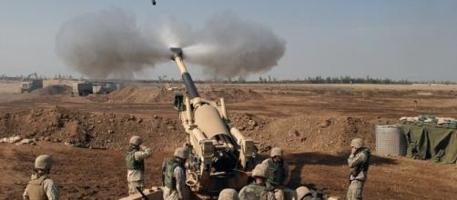 Iraqi army in batttle against the extremists.https://pixabay.com/en/howitzer-mortar-grenade-weapon-60542/